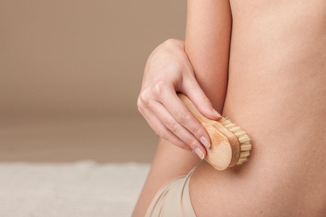 Santosa Detox Wellness Spa Phuket Women Brushes Her Skin